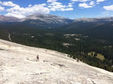 View of hiker atop the Lembert Dome