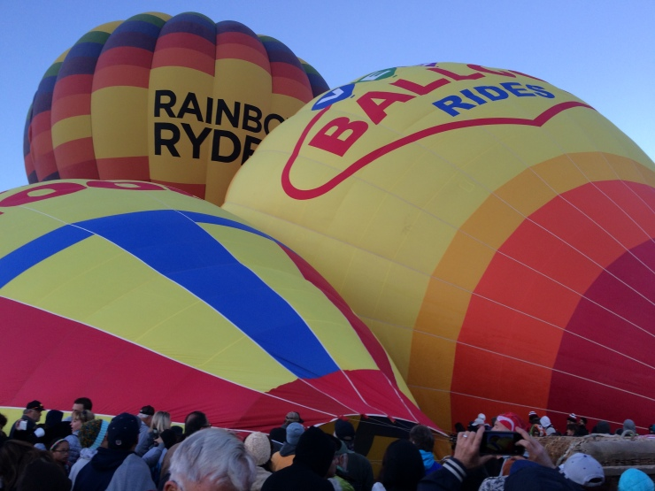 After they are rolled out, the balloons are filled with hot air