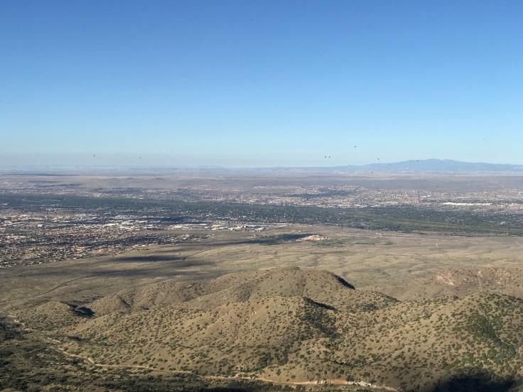 View of hot air balloons rising over Albuquerque