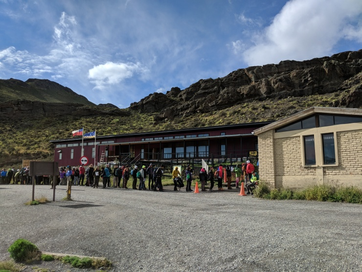 The line that quickly formed at the Laguna Amarga entrance to Torres del Paine National Park. Everyone is waiting to pay the park entrance fee and watch the safety video.