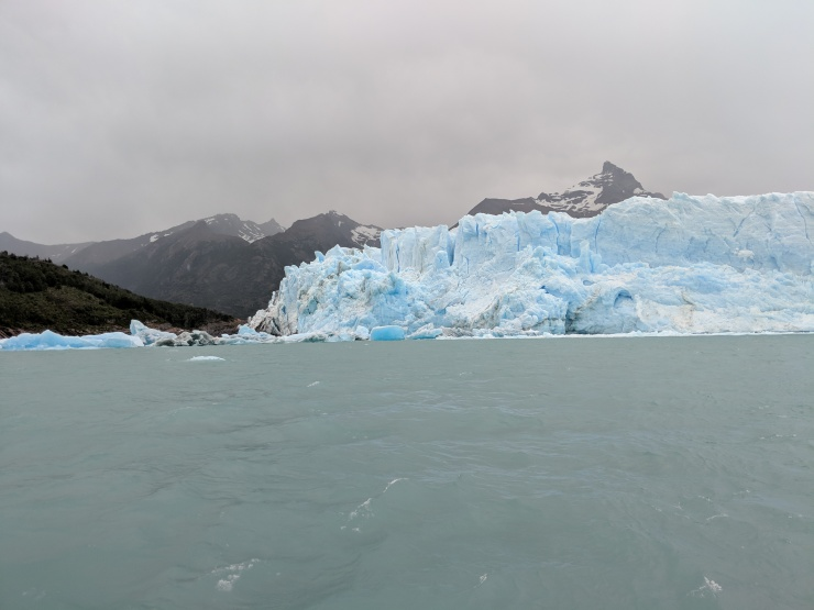 The Perito Moreno Glacier extends all the way to the land on the left side of this image, which is where the observation deck is located.