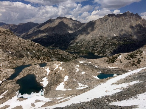 View looking down at the Rae Lakes basin from the top of Glen Pass.