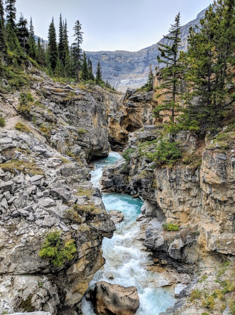View of the canyon from atop the bridge. You can see Bow Glacier Falls in the distance.