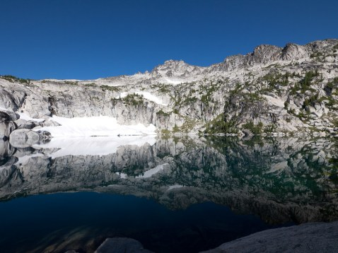 View of reflections in Inspiration Lake in the morning (credit: Brian Holsclaw)