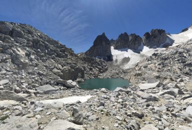 Near the top of Aasgard Pass there is a small lake below the steep Dragontail Peaks (credit: Chris Rapp)