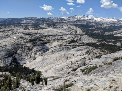 The vista is only a few minute hike from the junction and is well worth the effort. This is the view looking northwest at Tenaya Creek cascades through the canyon with snow peaks in the background.