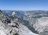 View from Clouds Rest looking into the Tenaya Canyon and Yosemite Valley and showing Half Dome and Mount Watkins