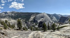Panoramic view showing the Merced River valley to the left and Bunnell Point and the Lost Valley to the right.
