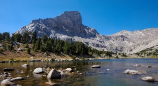 Around the 3.5 mile mark you reach a short junction that leads to Bear Lake and the unnamed lake next to it. This is the view from the first lake with Lizard Head Peak in the background (credit: John Strother)