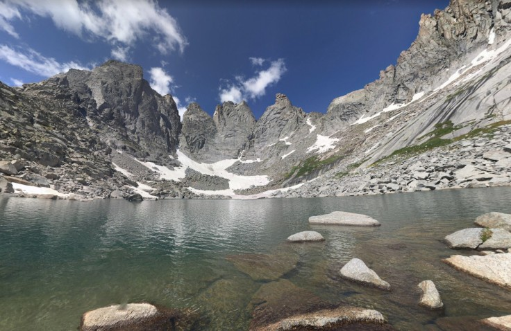 Cirque Lake is a modest scramble from the campsite. Here is the view from shore showing the prominent peaks of Overhang Tower, Sharks Nose, and Block Tower (credit: Mark Henn)