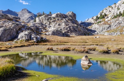 There is a small lake near the 1.3 mile mark along the Titcomb Basin Trail. This is shortly before the trail reaches Lake 10,548.