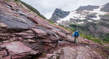 Passing one of several waterfalls along the Gunsight Pass Trail in Glacier National Park (credit: John Strother)