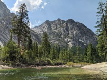 Cooling down in the Tuolumne River with a view of Colby Mountain, in Yosemite National Park